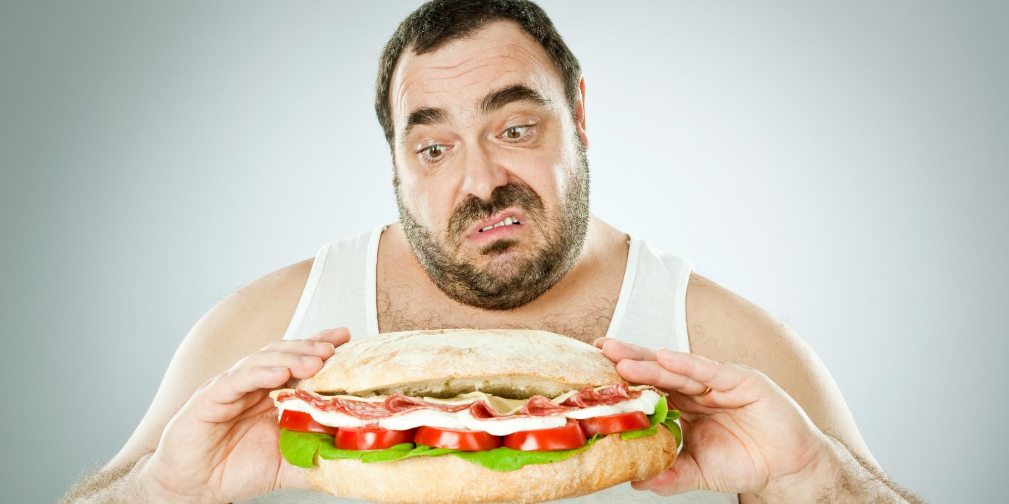 Man eats an enormous roll